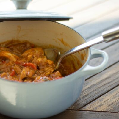Tender chicken thigh portions simmered in a rich and fragrant sauce and served with basmati rice; beware the sneaky kick.